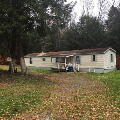 H74 -Nice and private on 5 acres on a back country road sits this fully renovated mobile home. Move in condition.  Quiet, nice back yard that takes you into the woods.