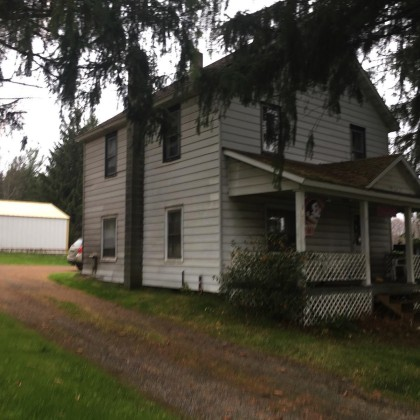 H91 -3 bedroom home with large back yard! There are 2 garages, one is 30x26 and a large pole garage 40x26. Very close to groomed snowmobile trails. Owners are ready to deal. Call today!