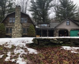 Totally secluded on 42 acres sits this real, full log home!